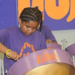 Dominique playing her steelpan drum!